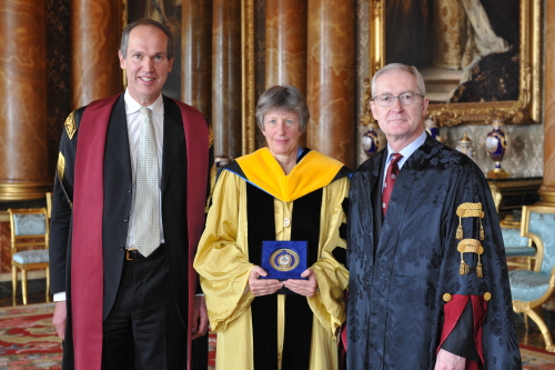 Queens Anniversary Prize.  Denis Burn, Chair of the Board of Trustees, Professor Katharine Cashman, leader of Bristol's Volcanology Group, and Professor Hugh Brady, Vice-Chancellor and President of the University of Bristol at Buckingham Palace