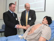 Dr Eugene Lloyd, Teaching Fellow, giving a demonstration to Professor David Eastwood on STAN - the Human Patient Simulator.