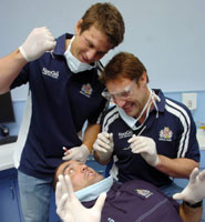 Members of Bristol Rugby team practise their dentistry skills