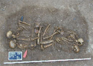 Group burial of a 4,600-year-old nuclear family, with the children (a boy of 8-9 and a boy of 5-4 years) buried facing their parents