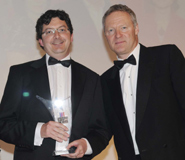 Left to right: Christian Carter, Personnel Manager at the University with Rory Bremner, satirist, who presented the Award.