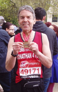 Dr Jonathan Nicholls with his London Marathon medal