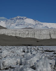 The ice margin of an Antarctic glacier, depicting frozen lake sediments in the foreground. When ice sheets form, they overrun organic matter such as that found in lakes, tundra and ocean sediments, which is then cycled to methane under the anoxic conditions beneath the ice sheet.