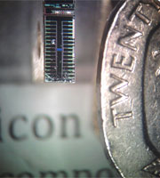 Example of a silicon quantum chip next to a 20 pence coin.