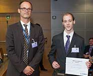Chris Howcroft receiving his award from Michael Schoenwetter, Head of Research and Technology Partnerships at Airbus
