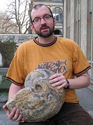 Dr Kenneth De Baets holding a full-grown manticoceratid (Manticoceras) from the Late Devonian of Morocco, one of the largest known ammonoids from this time