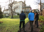 Volunteers survey the garden of Clifton Hill House