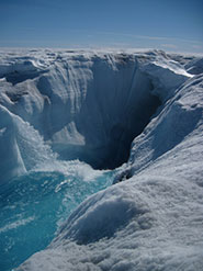 Moulins deliver surface meltwater through 1km of ice to the bed of the ice sheet