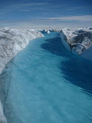Meltwater channels on the surface of the Greenland Ice Sheet; tracer results showed that similar types of channelized drainage are present at the ice sheet bed and beneath large ice thicknesses