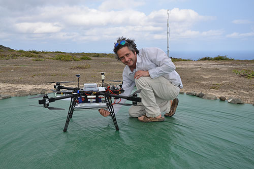 Image of Dr Rick Thomas and the updated system with flasks for air sampling