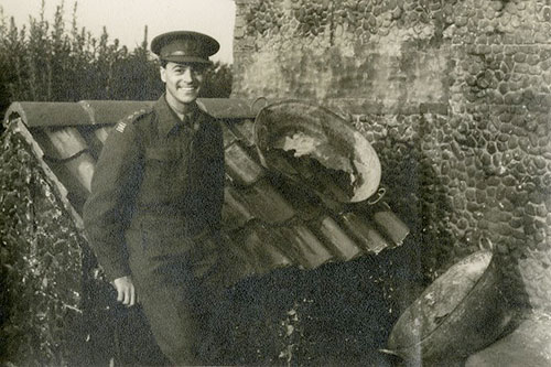 Image of Oliver Messel during the Second World War with fake farmhouse created to disguise military installation © University of Bristol Theatre Collection