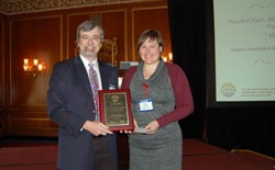 Steve Mahon of CSMantech awards Nicole Killat her prize