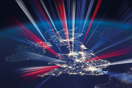 A photo of the United Kingdom at night, with red white and blue light overlaid