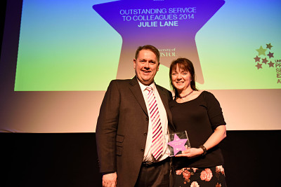 A photo of Julie Lane, Account Manager in Finance Services, Faculty of Science and winner of the Award for Outstanding Service to Colleagues at the 2014 Professional Services Excellence Awards ceremony, with Dominic Freda, Faculty Manager in Social Sciences and Law.
