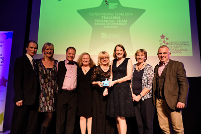 A photo of the Teaching Technical Team, Faculty of Medical and Veterinary Sciences, winners of the Award for Outstanding Team at the 2014 Professional Services Excellence Awards ceremony, with Angela Milln, Director of Student Recruitment, Access and Admissions.