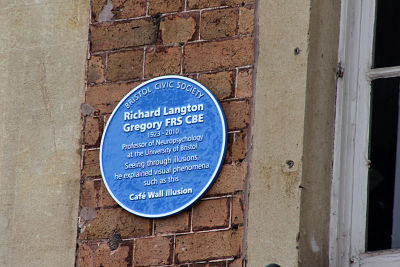 Blue plaque on wall
