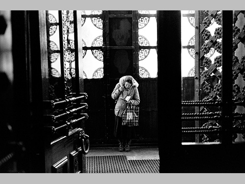'Praying - an elderly lady says a prayer in the entrance to a church in Moscow' by Harry Engels