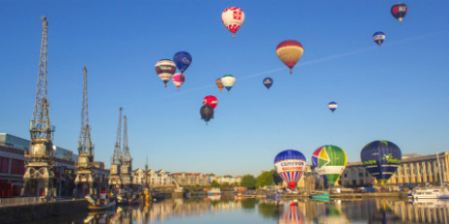View across Bristol harbourside, showing air balloons.