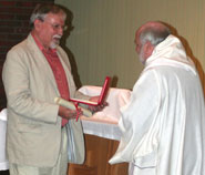 Mervyn Davies (left) is presented with his award by Revd Dr Jonathan Pye, Principal of Wesley College and a Research Fellow in the University's Centre for Medical Ethics, on behalf of Rt Revd Declan Lang, Bishop of Clifton.