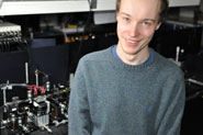 Research physicist Peter Shadbolt with the quantum optical chip.
