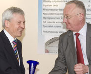 John Kirwan, Professor of Rheumatology, receives a trophy from the Vice-Chancellor