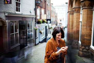 Image of woman with the InTouch device