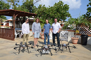 Image of the team with their three UAV's: (left to right) Dr Rick Thomas, Professor Jim Freer, Dr Colin Greatwood and Dr Tom Richardson