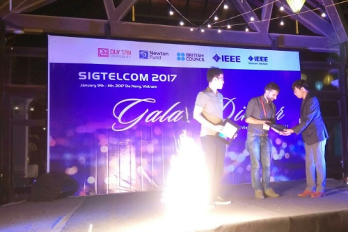 Image of Andrea Tassi receiving his prize for best paper at the Signal Processing, Telecommunications & Computing (SigTelCom) 2017 conference.