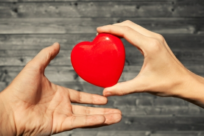 Generic image of two hands holding a heart