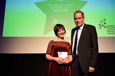 A photo of Ann Legg, Deputy Branch Supervisor, Arts and Social Sciences Library and winner of the Unsung Hero/Heroine Award at the 2014 Professional Services Excellence Awards ceremony, with Guy Orpen, Deputy Vice Chancellor.