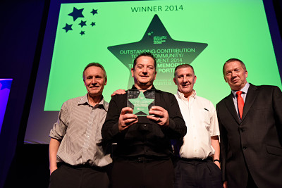 A photo of the Wills Memorial Building porters, winners of the Award for Outstanding Contribution to the Community/Environment at the 2014 Professional Services Excellence Awards ceremony, with George Banting, Dean of the Faculty of Medical and Veterinary Sciences.